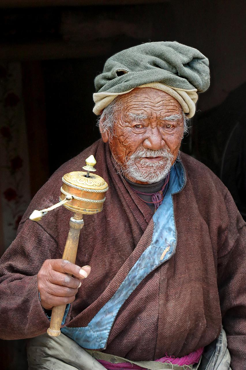 Old Man with prayer wheel
